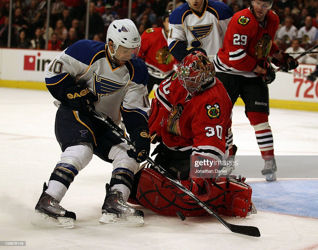 <a gi-track='captionPersonalityLinkClicked' href=/galleries/search?phrase=Marty+Turco&family=editorial&specificpeople=202549 ng-click='$event.stopPropagation()'>Marty Turco</a> #30 of the Chicago Blackhawks makes a save against <a gi-track='captionPersonalityLinkClicked' href=/galleries/search?phrase=Andy+McDonald+-+Ice+Hockey+Player&family=editorial&specificpeople=206576 ng-click='$event.stopPropagation()'>Andy McDonald</a> #10 of the St. Louis Blues at the United Center on October 18, 2010 in Chicago, Illinois. The Blackhawks defeated the Blues 3-2 in overtime.