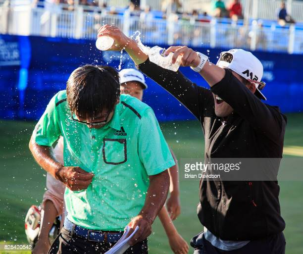 Marty Zecheng Dou has water dumped onto him by his coach Chen Zhu after winning the Digital Ally Open of the WEBCOM Tour at Nicklaus Golf Club at...