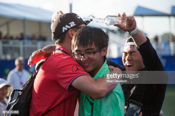Marty Zecheng Dou hugs Hao Guo as his coach Chen Zhu dumps water onto him after winning the Digital Ally Open of the WEBCOM Tour at Nicklaus Golf...