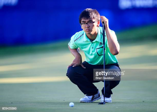 Marty Zecheng Dou studies his putt on the 17th hole during the Digital Ally Open of the WEBCOM Tour at Nicklaus Golf Club at Lionsgate on July 30...