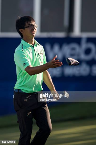 Marty Zecheng Dou throws his head cover on the 17th hole during the Digital Ally Open of the WEBCOM Tour at Nicklaus Golf Club at Lionsgate on July...