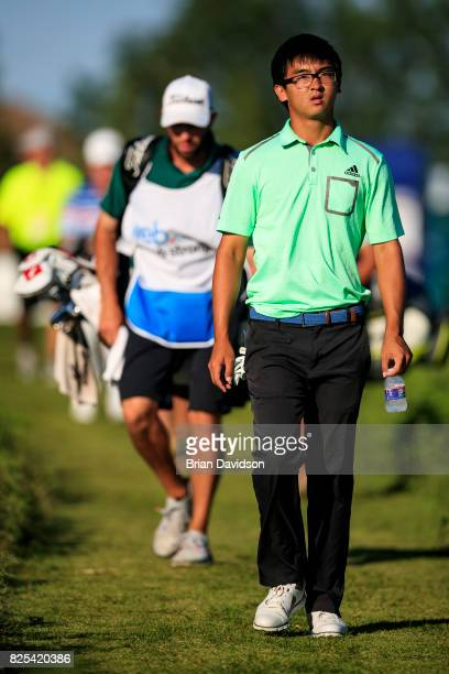 Marty Zecheng Dou walks onto the 18th hole during the Digital Ally Open of the WEBCOM Tour at Nicklaus Golf Club at Lionsgate on July 30 2017 in...