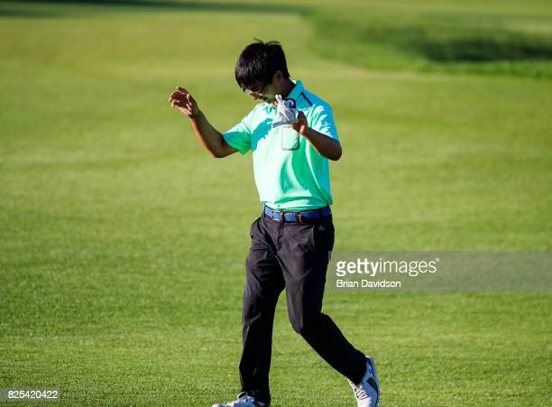 Marty Zecheng Dou waves to the crowd on the 18th hole during the Digital Ally Open of the WEBCOM Tour at Nicklaus Golf Club at Lionsgate on July 30...