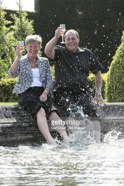 Martyn and Sandra White from Luton splash their feet in the pond of the Luton Hoo Hotel as they celebrate their 107 million National Lottery win...
