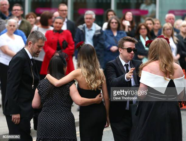 Martyn Hett's partner Russell Hayward greets mourners as the arrive for the funeral of Martyn Hett at Stockport Town Hall on June 30 2017 in...