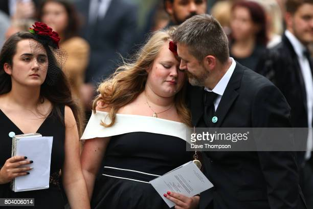 Martyn Hett's stepfather Stuart Murray comforts a mourner as they leave the funeral of Martyn Hett at Stockport Town Hall on June 30 2017 in...