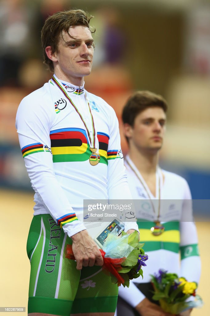Martyn Irvine (L)of Ireland celebrates on the winners podium after claiming gold alongside Luke Davison (R) of Australia who claimed bronze in the men's scratch race final during day two of the UCI Track World Championships at Minsk Arena on February 21, 2013 in Minsk, Belarus.