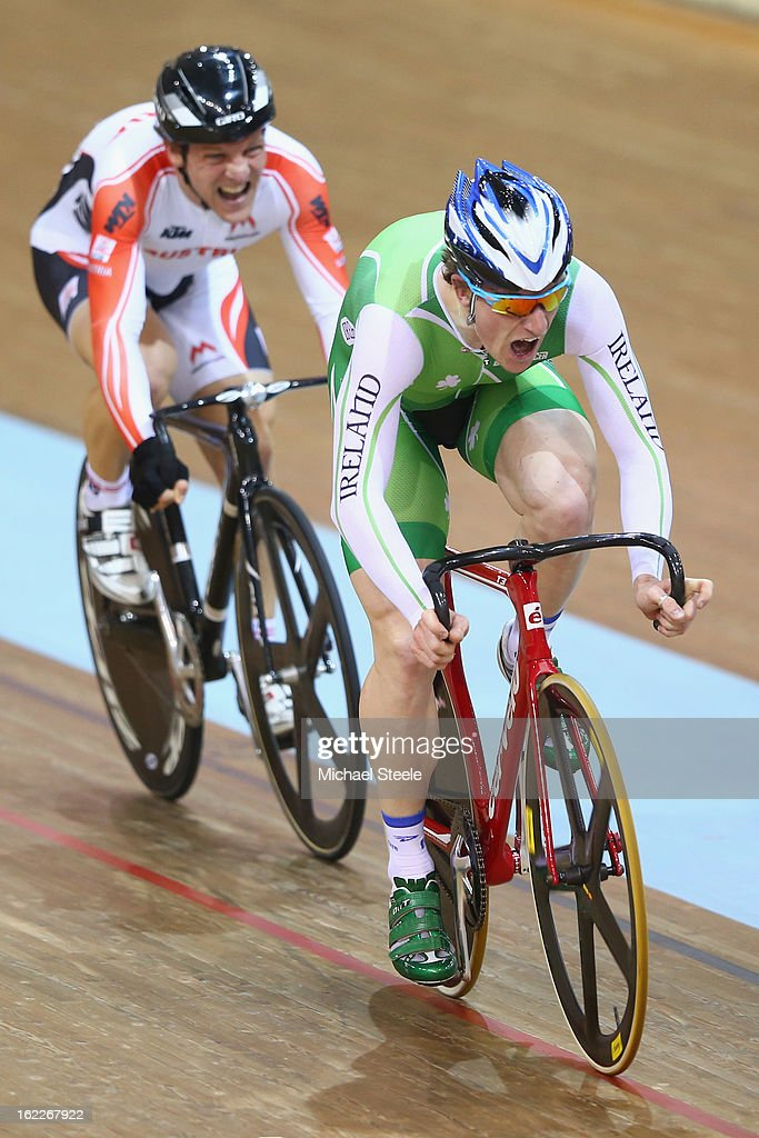 Martyn Irvine (R) of Ireland crosses the finishing line from Andreas Mueller (R) of Austria to win gold in the men's scratch race final during day two of the UCI Track World Championships at Minsk Arena on February 21, 2013 in Minsk, Belarus.