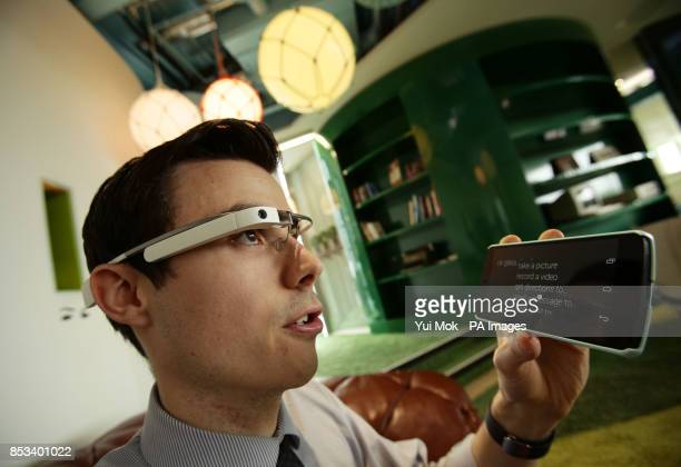 Martyn Landi Technology Reporter of The Press Association operates a pair of Google Glass on a paired phone during a demonstration at Google in...
