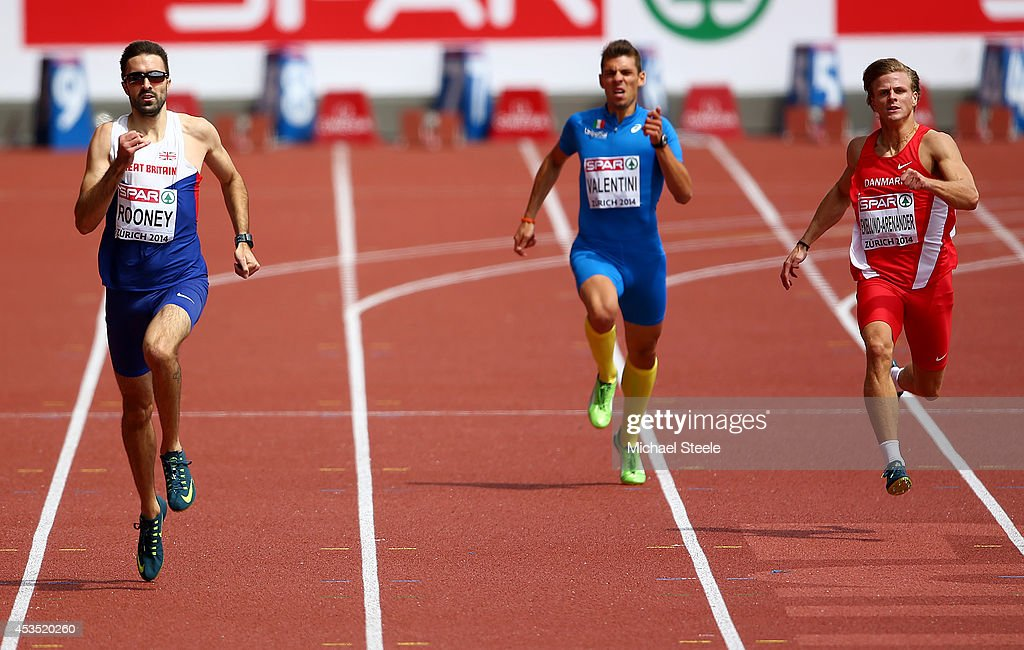 Martyn Rooney of Great Britain and Northern Ireland, Lorenzo Valentini of Italy and competes in the Men's 400 metres heats during day one of the 22nd European Athletics Championships at Stadium Letzigrund on August 12, 2014 in Zurich, Switzerland.