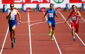 Martyn Rooney of Great Britain and Northern Ireland Lorenzo Valentini of Italy and competes in the Men's 400 metres heats during day one of the 22nd...