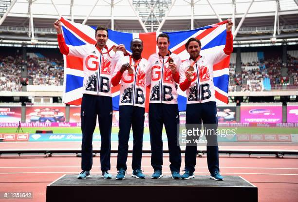 Martyn Rooney of Great Britain Andrew Steele of Great Britain Robert Tobin of Great Britain and Michael Bingham of Great Britain collect their 4x400m...