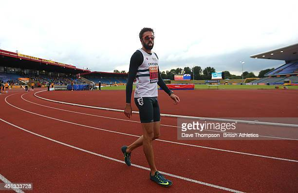 Martyn Rooney sticks out his tongue after winning his Men's 400metre heat during day one of the Sainsbury's British Championships at Birmingham...
