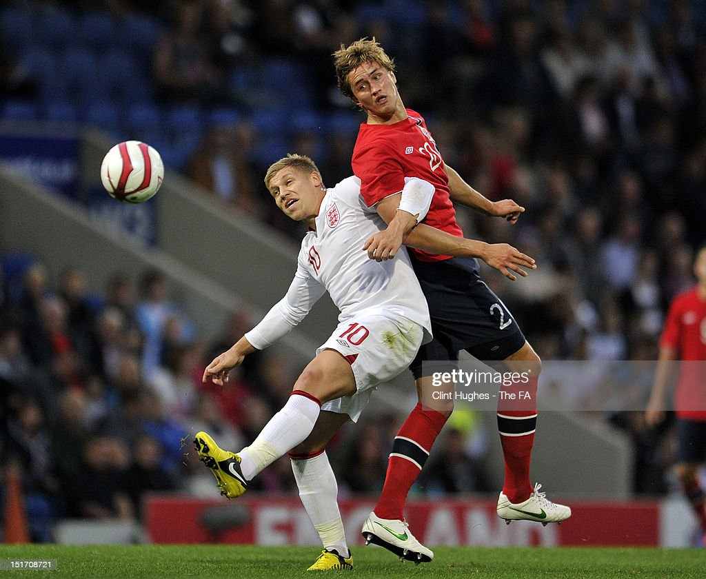 Martyn Waghorn of England and Thomas Rogne (R) of Norway compete for the ball during the UEFA Under 21 Championship match between England and Norway at the B2NET Stadium on September 10, 2012 in Chesterfield, England