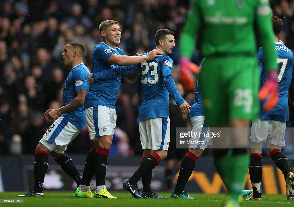 Martyn Waghorn of Rangers celebrates after Brad McKay of Inverness defect's his cross in to score an own goal during the Scottish Premier League match between Rangers and Inverness Caledonian Thistle at Ibrox Stadium on December 24, 2016 in Glasgow, Scotland.