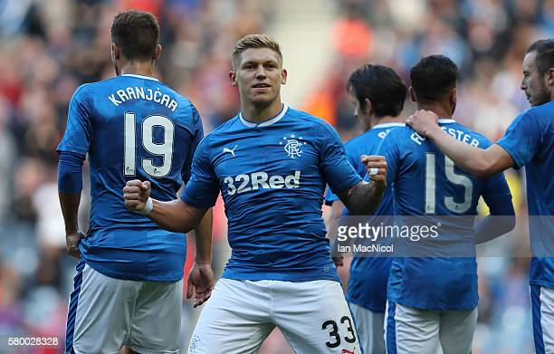 Martyn Waghorn of Rangers celebrates scoring his second goal during the Betfred Cup match between Rangers and Stranraer at Ibrox Stadium on July 25...