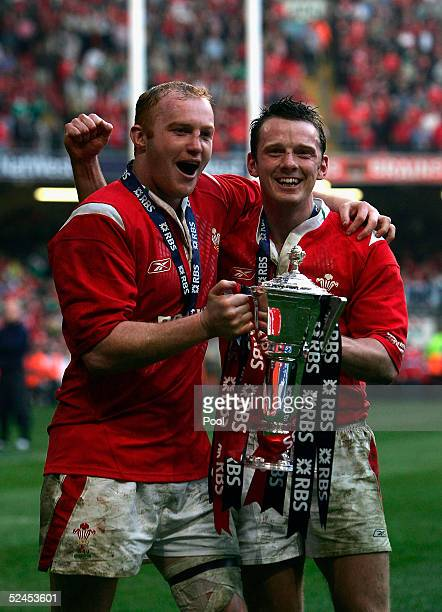 Martyn Williams and Kevin Morgan hold aloft the trophy after winning the Grand Slam by beating Ireland in the RBS Six Nations International between...