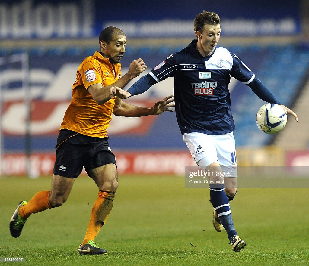 Martyn Woolford of Millwall holds off Wolves' <a gi-track='captionPersonalityLinkClicked' href=/galleries/search?phrase=Karl+Henry&family=editorial&specificpeople=2093810 ng-click='$event.stopPropagation()'>Karl Henry</a> during the npower Championship match between Millwall and Wolverhampton Wanderers at The Den on March 05, 2013 in London, England,