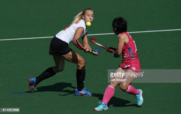 Martyna Wypijewska of Poland and Akiko Kato of Japan battle for possession during day 4 of the FIH Hockey World League Semi Finals Pool B match...