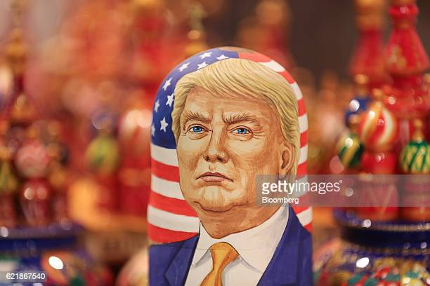 A martyoshka doll showing Donald Trump US president elect sits on display in a souvenir store in Moscow Russia on Wednesday Nov 9 2016 The ruble...