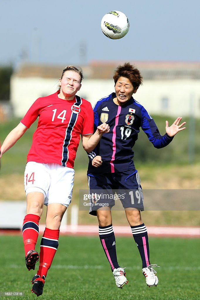 Marumi Yamazaki MF of Japan challenges Ingvild Isaksen FW of Norway during the Algarve Cup match between Japan and Norway at the Complexo Desportivo Belavista on March 6, 2013 in Parchal, Portugal.