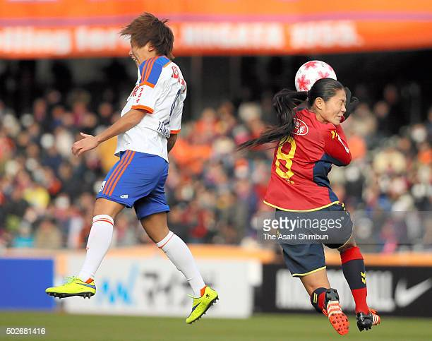 Marumi Yamazaki of Albirex Niigata Ladies and Homare Sawa of INAC Kobe Leonessa compete for the ball during the 37th Empress's Cup All Japan Women's...