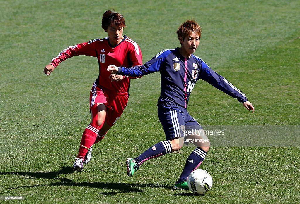 Marumi Yamazaki of Japan challenges Han Peng of China during the Algarve Cup 2013 fifth place match at the Estadio Algarve on March 13, 2013 in Faro, Portugal.