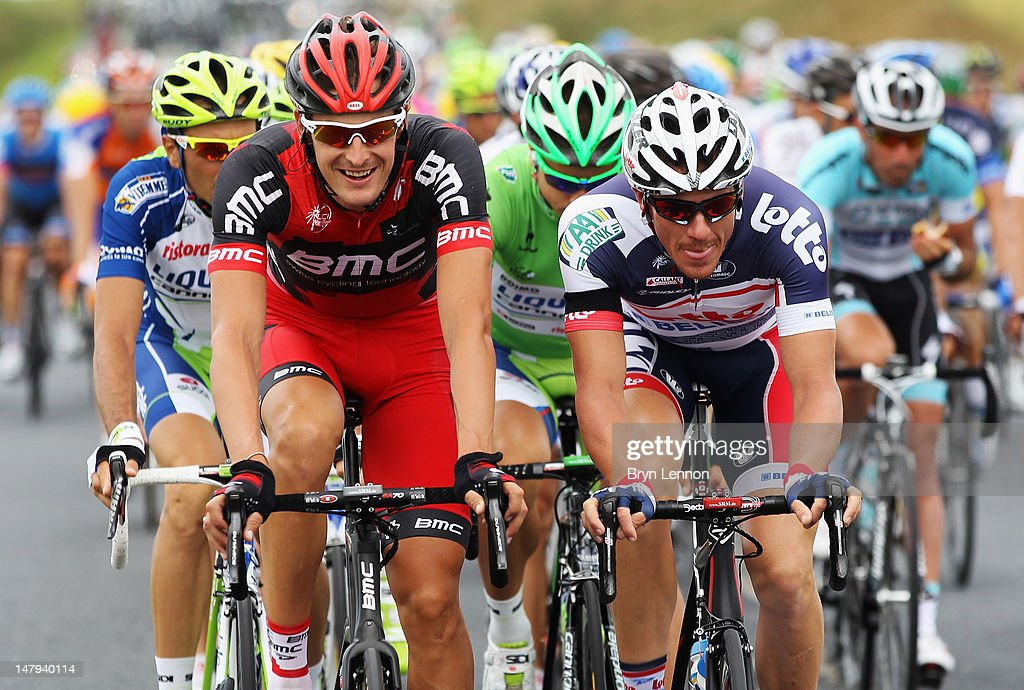 Marus Burghardt (l) of Germany and the BMC Racing Team rides with Adam Hansen of Australia and the Lotto Belisol team during stage five of the 2012 Tour de France from Rouen to Saint-Quentin on July 5, 2012 in Saint-Quentin, France.