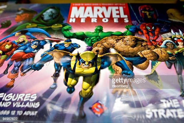 Marvel comic book characters including Wolverine Captain America and the Incredible Hulk appear on a Marvel Heroes board game displayed for a...