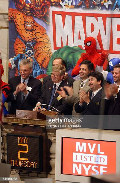 Marvel President and CEO Peter Cuneo Marvel comics hero Spiderman other Marvel executives and NYSE Executive Vice President of Communications Bob...