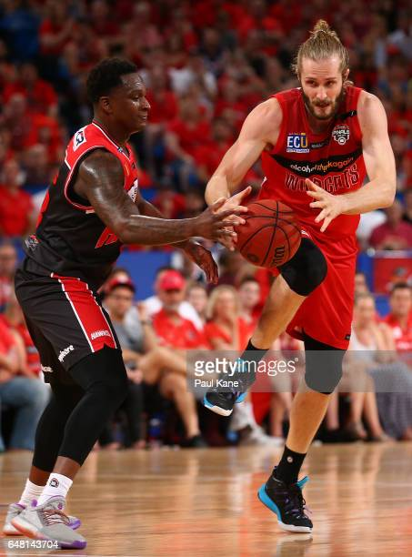 Marvelle Harris of the Hawks and Jesse Wagstaff of the Wildcats contest for the ball during game three of the NBL Grand Final series between the...