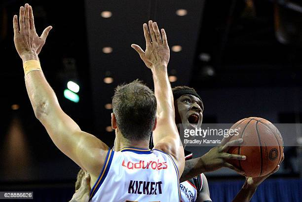 Marvelle Harris of the Hawks takes on the defence as he drives to the basket during the round 10 NBL match between the Brisbane Bullets and the...