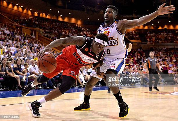 Marvelle Harris of the Hawks takes on the defence of Jermaine Beal of the Bullets during the round 11 NBL match between the Brisbane Bullets and...