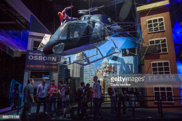 Marvel's SpiderMan character is seen atop a helicopter over people in the PlayStation exhibit area on opening day of the Electronic Entertainment...