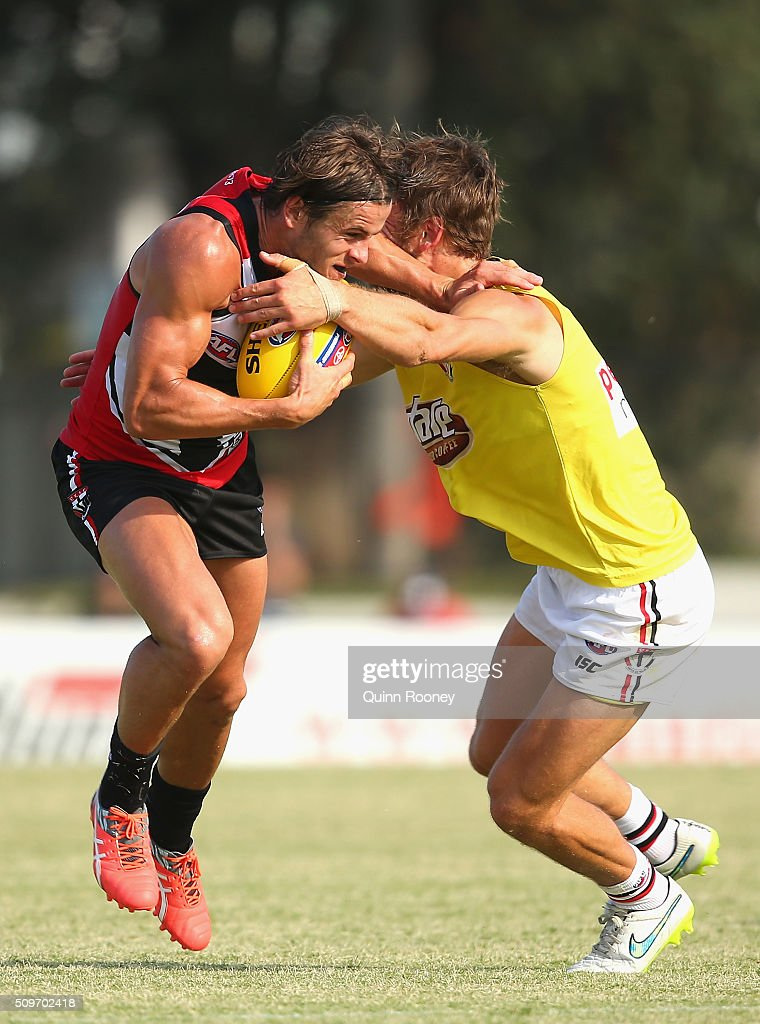 Marverick Weller of the Saints fends off a tackle by Josh Saunders during the St Kilda Saints AFL Intra-Club Match at Trevor Barker Beach Oval on February 12, 2016 in Melbourne, Australia.