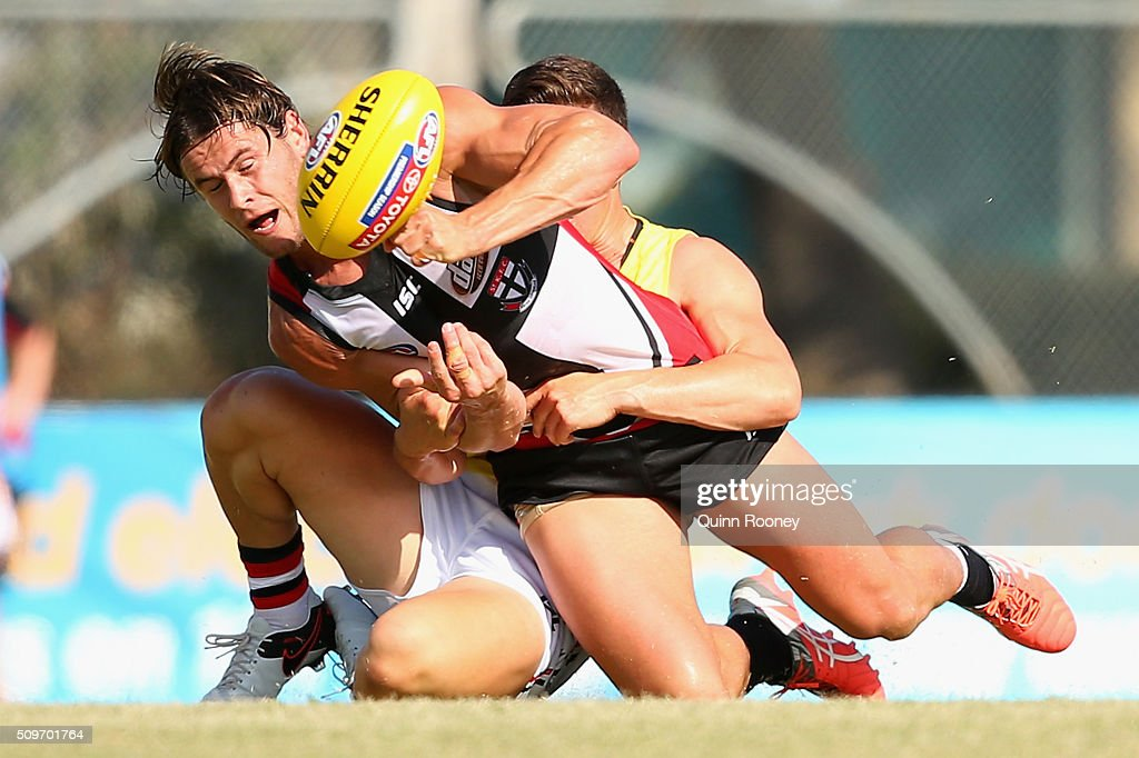 Marverick Weller of the Saints handballs whilst being tackled by Jade Gresham during the St Kilda Saints AFL Intra-Club Match at Trevor Barker Beach Oval on February 12, 2016 in Melbourne, Australia.