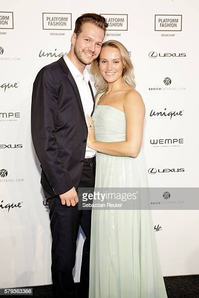 Marvin Albrecht and Anna Hofbauer attend the Unique show during Platform Fashion July 2016 at Areal Boehler on July 23 2016 in Duesseldorf Germany