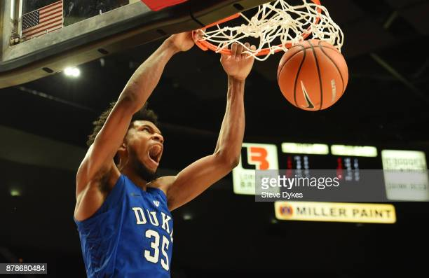 Marvin Bagley III of the Duke Blue Devils dunks the ball late in the second half of the game against the Texas Longhorns during the PK80Phil Knight...