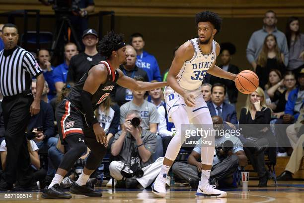 Marvin Bagley III of the Duke Blue Devils moves the ball against Keith Braxton of the St Francis Red Flash at Cameron Indoor Stadium on December 5...