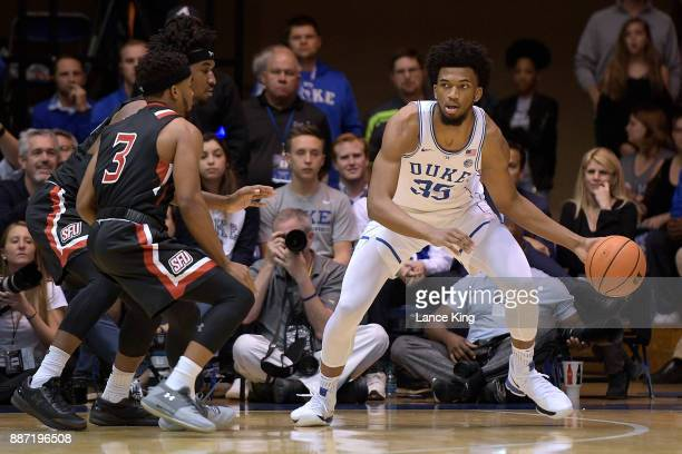 Marvin Bagley III of the Duke Blue Devils moves the ball against Keith Braxton and Jamaal King of the St Francis Red Flash at Cameron Indoor Stadium...