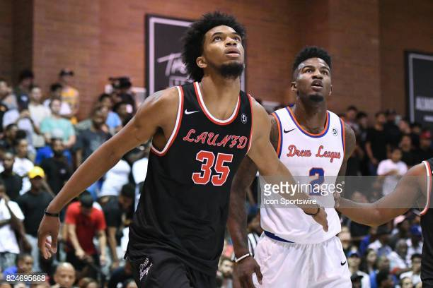 Marvin Bagley Jr the top high school recruit in the class of 2018 boxes out Golden State Warriors forward Jordan Bell during a Drew League game at...