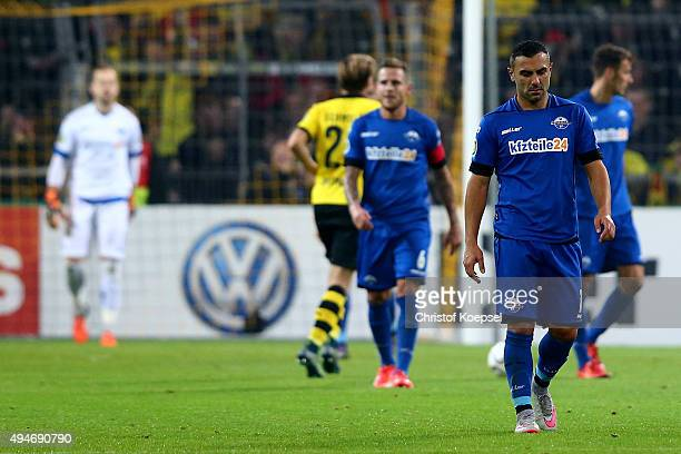 Marvin Bakalorz and Mahir Saglik of Paderborn look dejected after the forth goal of Dortmund during the DFB Cup match between Borussia Dortmund and...