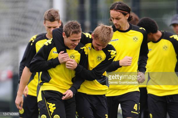 Marvin Bakalorz of Dortmund and team mate Sven Bender joke during a training session at the Dortmund Brackel training ground ahead of their UEFA...