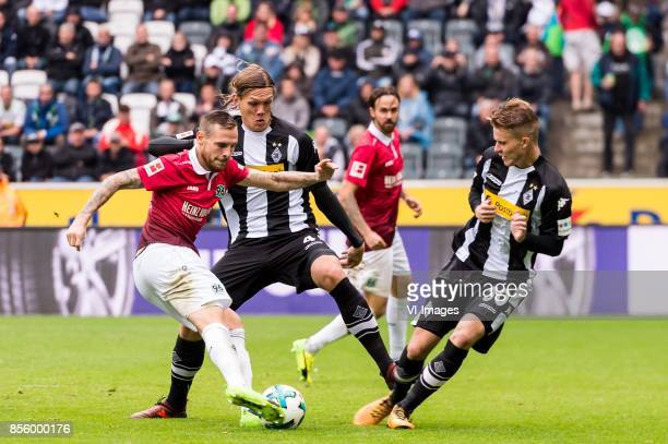 Marvin Bakalorz of Hannover 96 Jannik Vestergaard of Borussia Monchengladbach Nico Elvedi of Borussia Monchengladbach during the Bundesliga match...