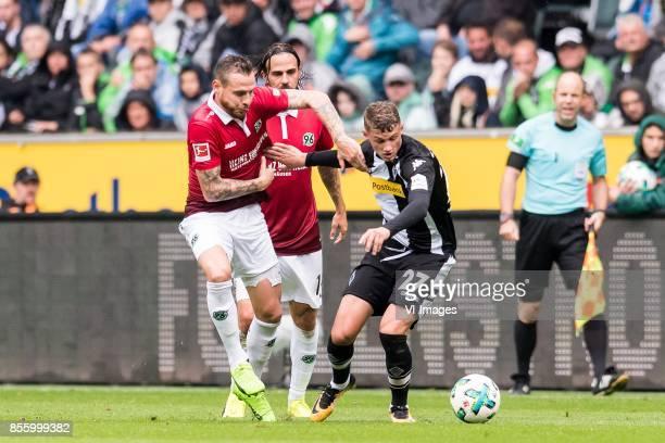 Marvin Bakalorz of Hannover 96 Martin Harnik of Hannover 96 Michael Cuisance of Borussia Monchengladbach during the Bundesliga match between Borussia...