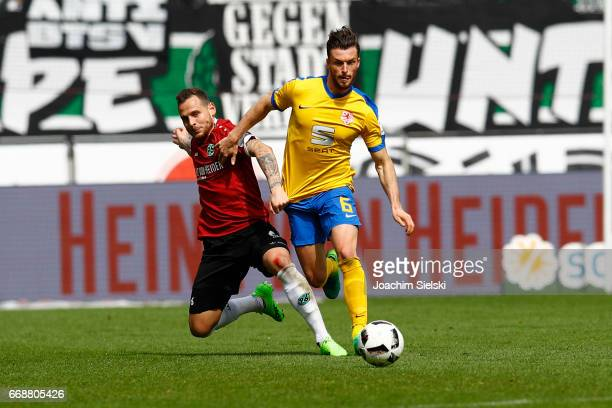 Marvin Bakalorz of Hannover challenges Quirin Moll of Braunschweig during the Second Bundesliga match between Hannover 96 and Eintracht Braunschweig...