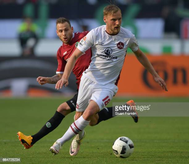 Marvin Bakalorz of Hannover is challenged by Hanno Behrens of Nuernberg during the Second Bundesliga match between Hannover 96 and 1 FC Nuernberg at...