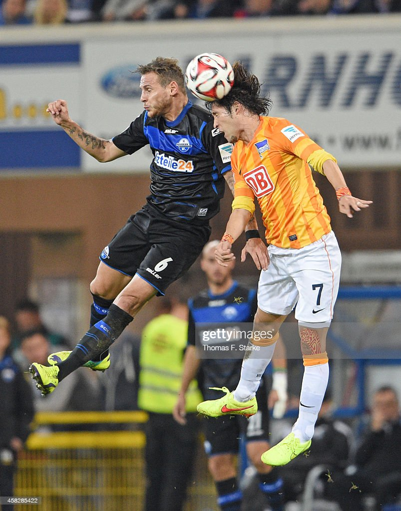 Marvin Bakalorz of Paderborn and Hajime Hosogai of Berlin head for the ball during the Bundesliga match between SC Paderborn and Hertha BSC at...