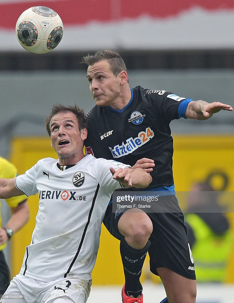 Marvin Bakalorz (R) of Paderborn and Manuel Stiefler of Sandhausen head for the ball during the Second Bundesliga match between SC Paderborn and SV Sandhausen at Benteler Arena on April 27, 2014 in Paderborn, Germany.