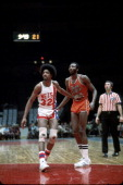 Marvin Barnes of the Spirits of St Louis grabs the arm of Julius Erving of the New York Nets during an American Basketball Association game at Nassau...